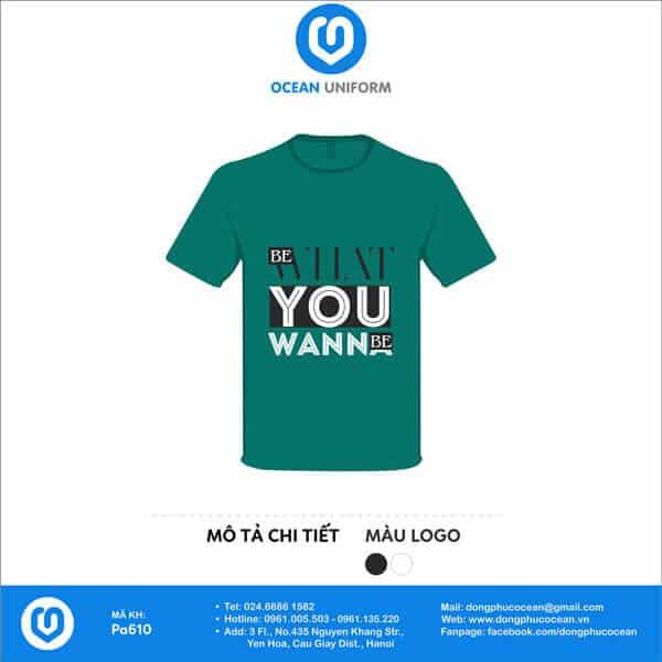 Áo nhóm Be What You Wanna Be với dòng chữ in rõ ràng hai màu trắng đen nổi bật trên nền áo xanh.